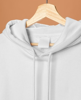 White sports sweatshirt with clothing tag close-up
