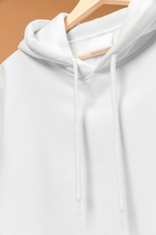 White sports sweatshirt with clothing tag and laces