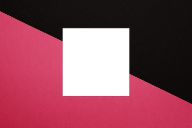 黒とピンクの背景に白い正方形のモックアップ。テクスチャー