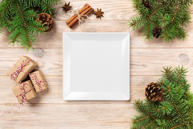 White square plate on a table with christmas decoration