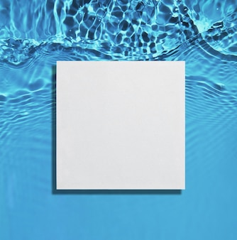 White square podium on the blue water surface background flat lay copy space