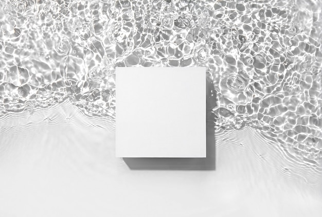 White square podium on the water surface background flat lay copy space