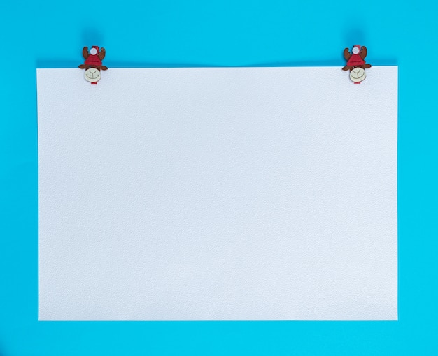 White square sheet of paper on a blue background