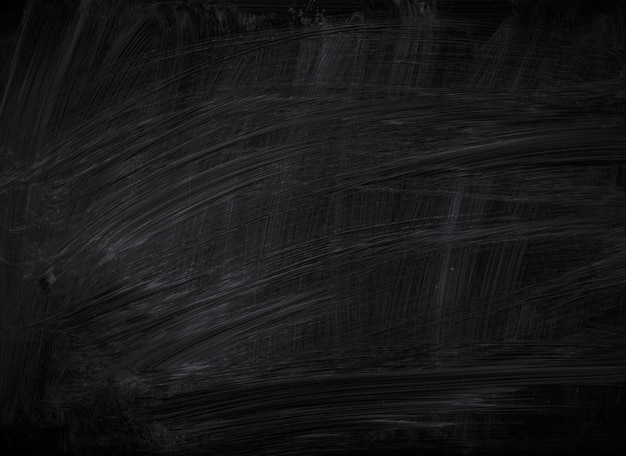 Белые пятна мела на черной доске на фоне