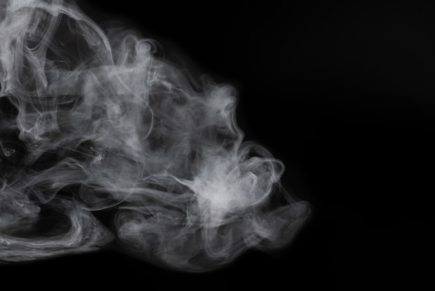White steam on a black background. copy space.