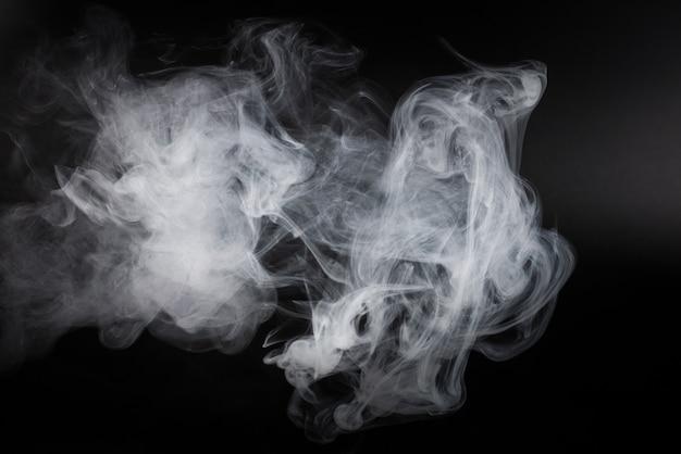 White steam on a black background.