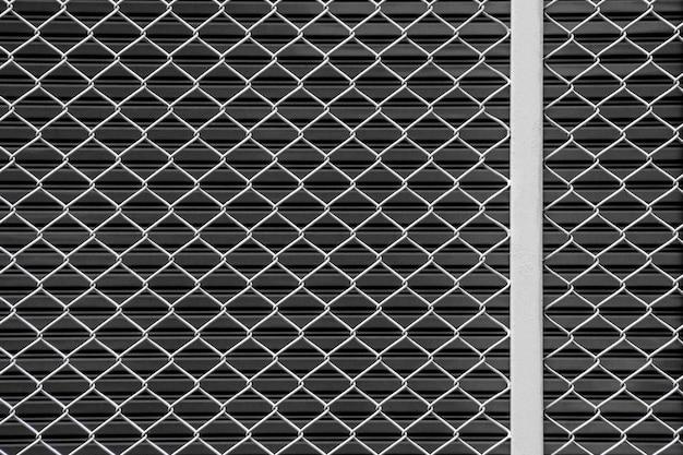 White steel grating front the black metal door