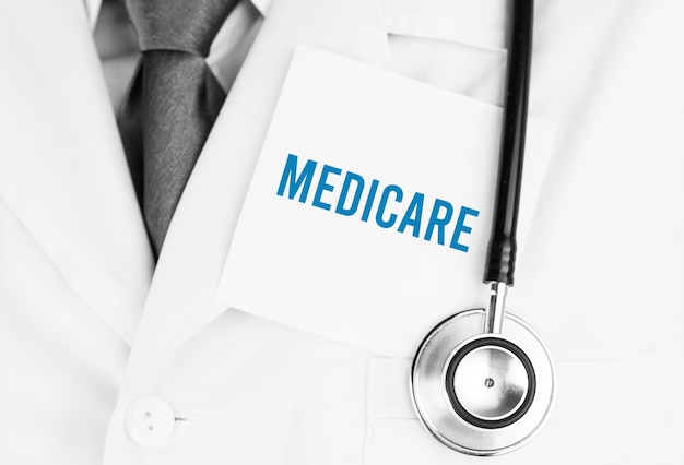 White sticker with text medicare lying on medical robe with a stethoscope