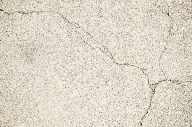 White stone floor with a cross-shape crack
