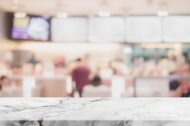 빈티지 필터와 화이트 스톤 테이블 상단과 흐리게 레스토랑 인테리어 배경-디스플레이에 사용하거나 제품을 몽타주 할 수 있습니다.