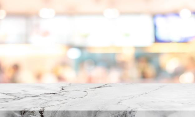 화이트 스톤 테이블 상단 및 흐리게 레스토랑 주방 인테리어 배경-디스플레이에 사용하거나 제품을 몽타주 할 수 있습니다.