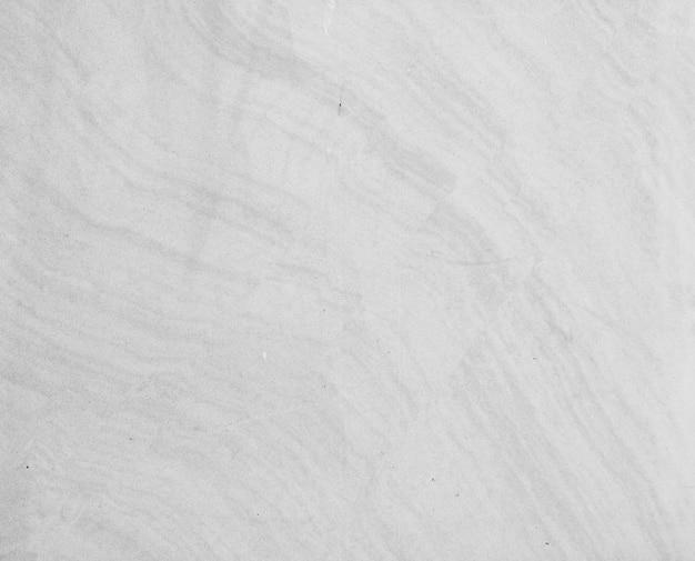 Белая каменная структура с прожилками. фон.