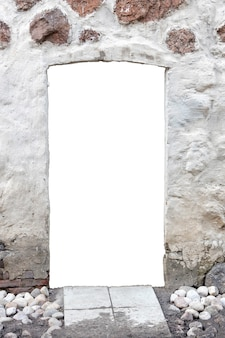White stone wall with a hole in the middle. isolated on white background. window in the wall. vertical frame. high quality photo