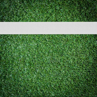 White stripe on the green soccer field from top view