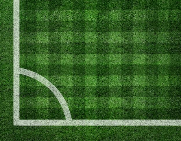 Белая полоса на зеленом футбольном поле сверху