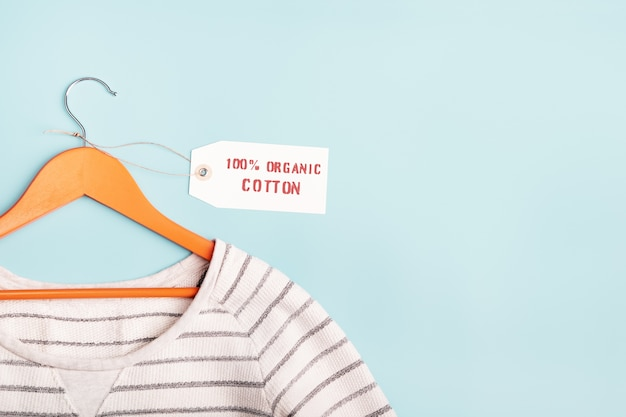 White striped sweatshirt on a hanger and tag