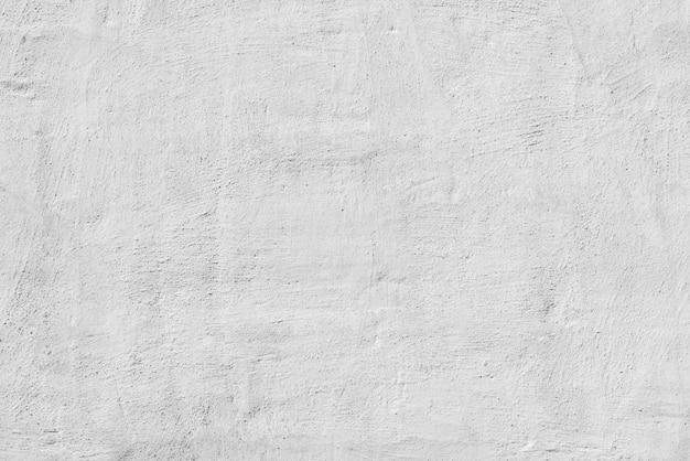 白い漆喰の質感。デザイナーインテリアの背景。抽象的な建築表面。