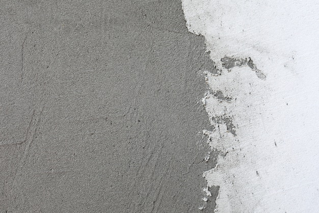 白い漆喰壁の背景。白い塗られたセメントの壁のテクスチャ。フレーム全体のシャープネス