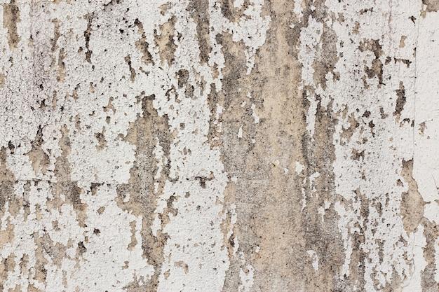 Белая лепная стена с краской в качестве фона