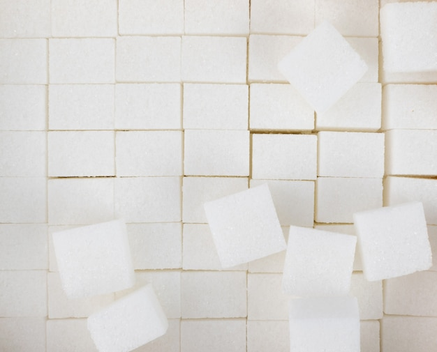 White sugar cubes textured background top view. refined white sugar cube