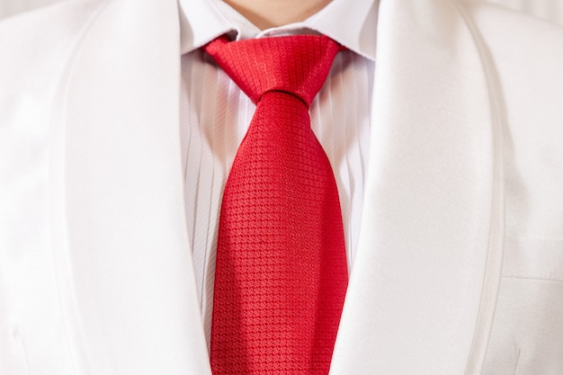 White suit and red necktie