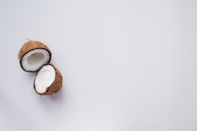 White surface with coconut cut in half