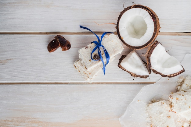 White sweets on light wooden table