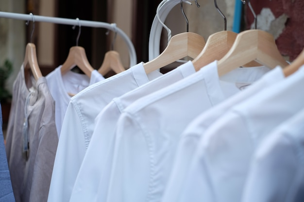 White t-shirt on hangers