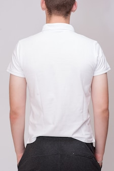White t-shirt on a young man isolated, back