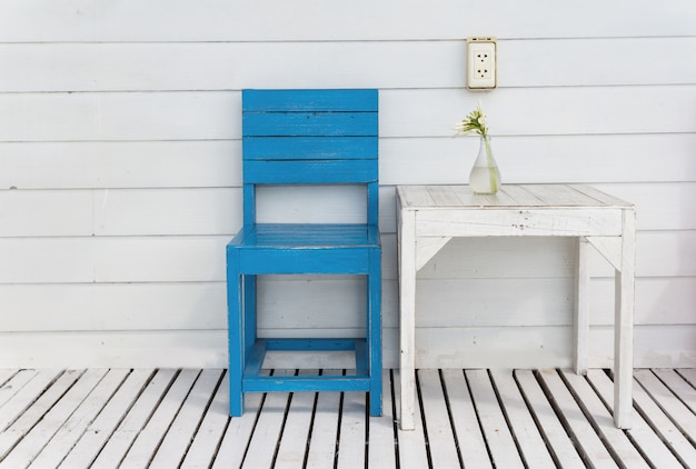 White table and blue wooden chair outdoor
