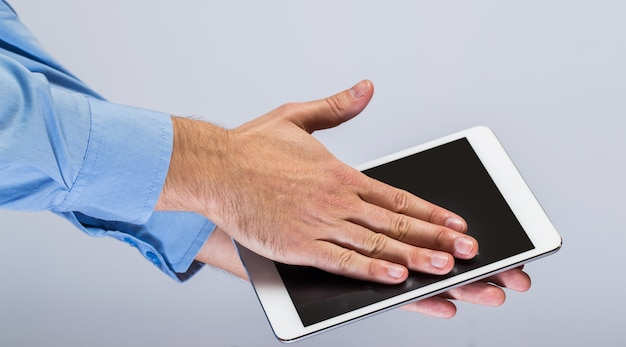 White tablet pc in hands
