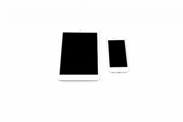 White tablet and smartphone. smartphone with glare on the screen