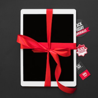 White tablet with ribbon near sale stickers