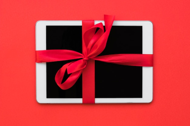 White tablet with ribbon