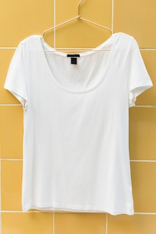 White tee hanging on the wall