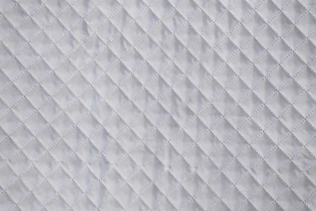 White textile texture with checkered mesh embossing background