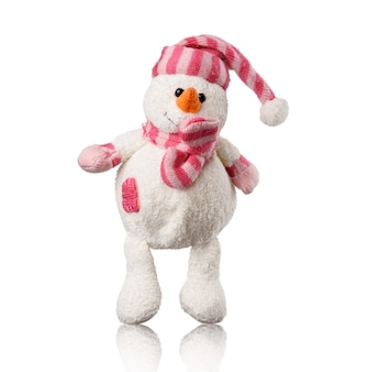 White textile toy snowman in pink hat and scarf isolated on white background, close up