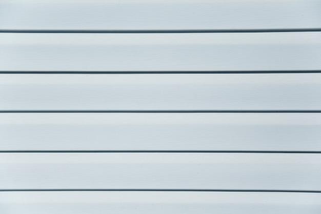 家の壁、白いストリップ、ボード、スラットの白いテクスチャと背景