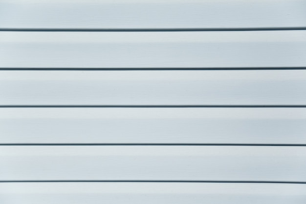 White texture and background of house wall, white strips, boards, slats