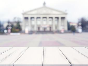 White texture desk in front of blur public building