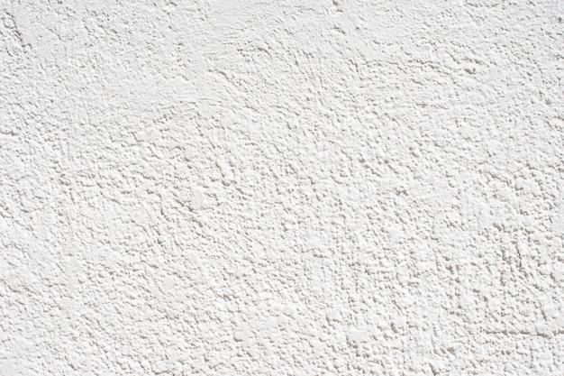 しっくいの壁の白い質感、コンクリートの壁のしっくいの層。デザインやテクスチャの背景に最適です。
