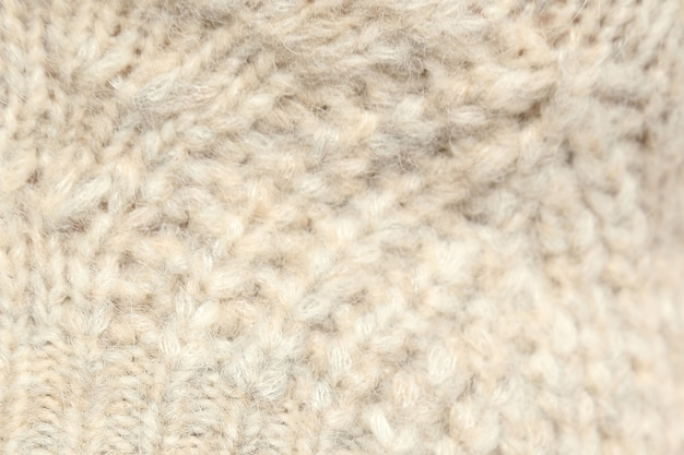 白い質感のウールのクローズアップ、織布、ニット生地