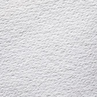 Белая текстурированная бумага крупным планом над видом