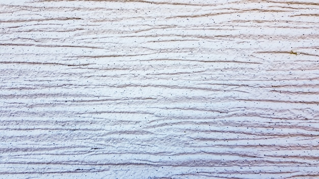 White textured plaster texture. decorative wall covering with horizontal stripes. background for text. light modern abstract background.
