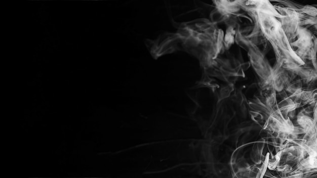 White textured wispy smoke against black background