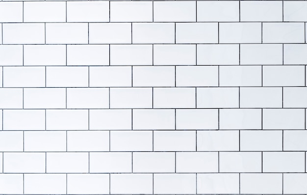 White tile background wall with white tiles for the interior of the kitchen or bathroom in the house...