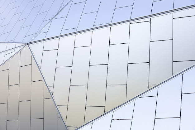White tiled relief wall of modern geometrically ed building