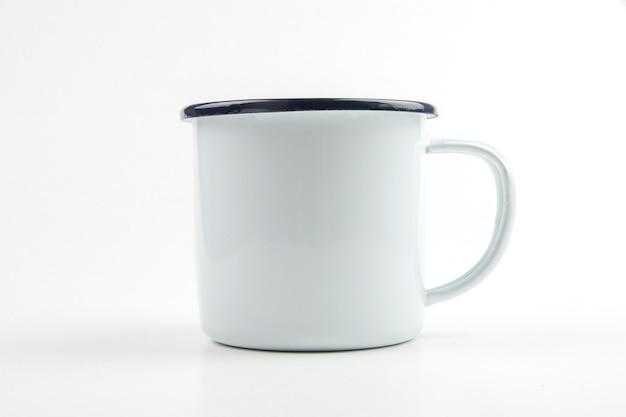 White tin cup.