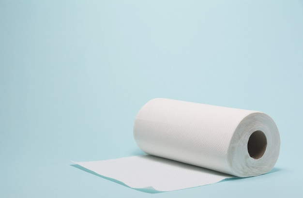 White tissue paper, toilet paper on blue background.