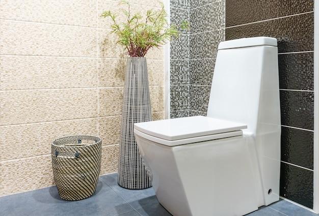 White toilet bowl in modern bathroom at hotel